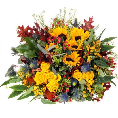 Flores de colores cálidos y soleados con Garantía de Sonrisa.